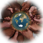 Circle of interracial hands around earth