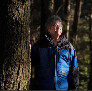 Wanda Culp standing amongst old growth trees